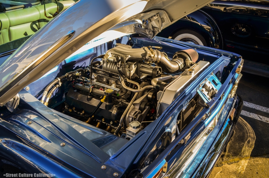 I don't know how the owner was able to fit this huge blown V8 under the hood of this old Ford pickup.