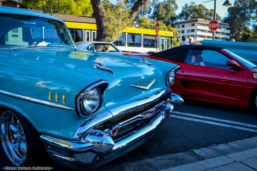 A '57 BelAir next to a Ferrari 355 Spider